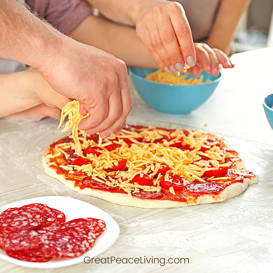 Hands making pizza