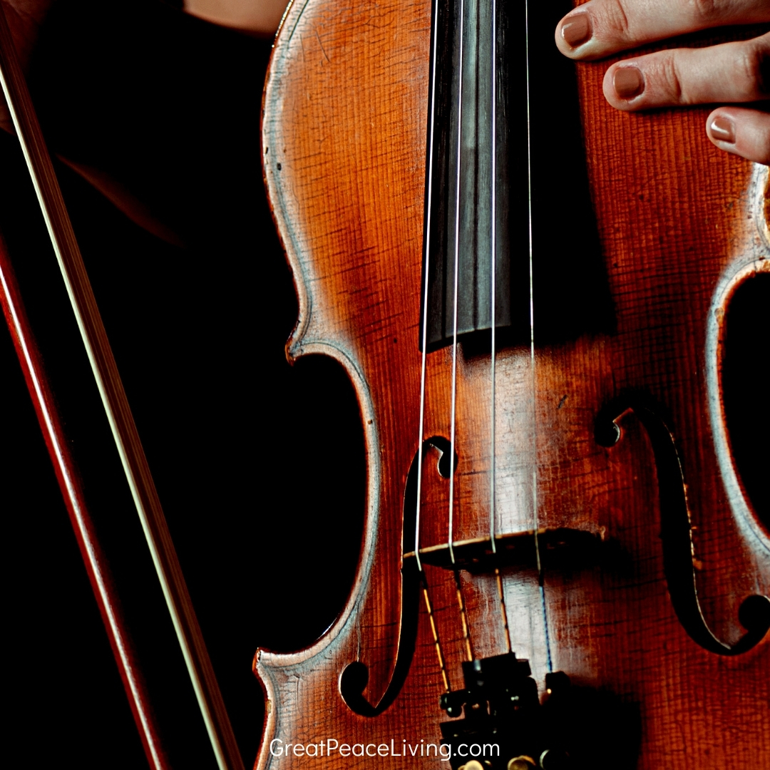 Photo of violin with text that reads, How to Teach Music in Homeschool | GreatPeaceLiving.com